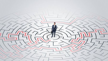 Young entrepreneur standing in a middle of a labyrinth