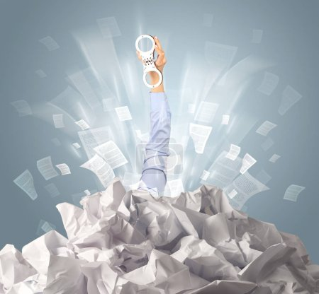 Photo for Hand coming out from a huge paper pile - Royalty Free Image