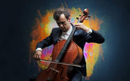Photo for Young classical musician with colorful splotch wallpaper - Royalty Free Image