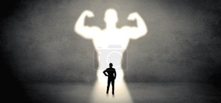 Photo for Businessman standing and dreaming about a strong superhero - Royalty Free Image