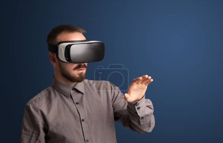 Photo for Amazed businessman with virtual reality goggles - Royalty Free Image