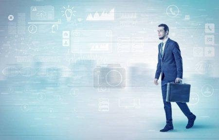 Businessman walking with database concept around
