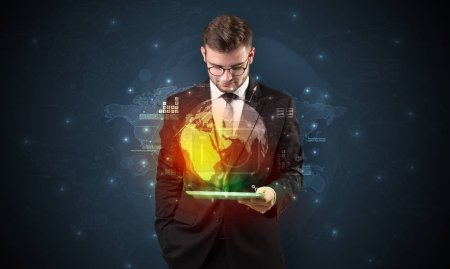 Photo for Spectacled businessman with global hologram concept and tablet on his hand - Royalty Free Image