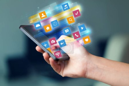 Photo pour Main à l'aide de téléphone avec coloré rapide mobile application icônes et symboles concept - image libre de droit