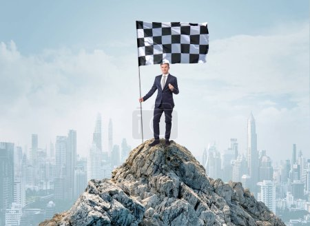 Photo for Successful businessman on the top of a city holding goal flag - Royalty Free Image