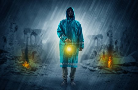 Photo for Destroyed place after a catastrophe with man in raincoat and lantern concept - Royalty Free Image