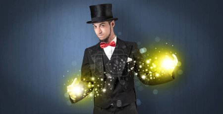 Handsome illusionist holding his superpower on his...