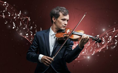 Photo for Lonely musical composer with violin and sparkling musical notes around - Royalty Free Image