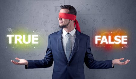 Photo for Businessman with red ribbon on his eye deciding true or false - Royalty Free Image