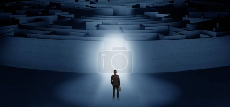 Photo for Businessman getting ready to enter a concentric labyrinth with lighted entrance concept - Royalty Free Image