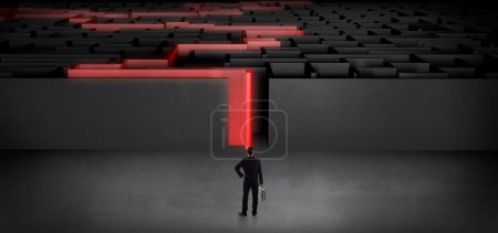 Photo for Businessman getting ready to enter the dark labyrinth with stated road concept - Royalty Free Image