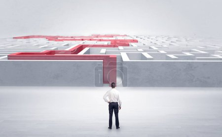 Photo for Businessman getting ready to enter the labyrinth with stated road concept - Royalty Free Image