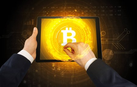 Photo for Elegant hand touching tablet with cryptocurrency concept - Royalty Free Image
