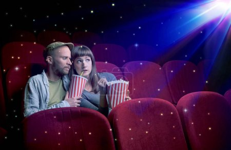 Photo for Lovely couple watching 3D movie with little sparkling stars around - Royalty Free Image