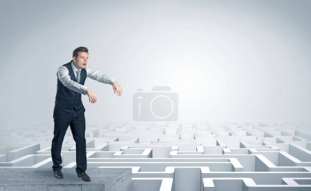Photo for Zombi elegant businessman on the top of a labyrinth - Royalty Free Image