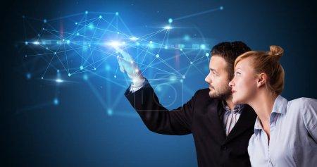 Man and woman touching web hologram