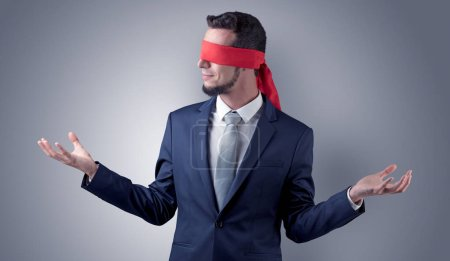 Photo for Covered eye, indecisive businessman standing blind in front of a wall - Royalty Free Image