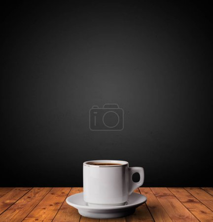 Photo for Cup of drink on wooden table with dark background - Royalty Free Image