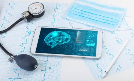 Photo for Brain functionality report with medical devices around - Royalty Free Image