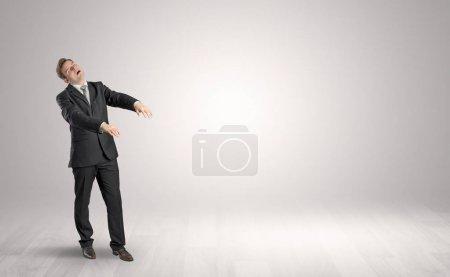 Photo for Zombi, sleepy maniac businessman walking in a copy space - Royalty Free Image