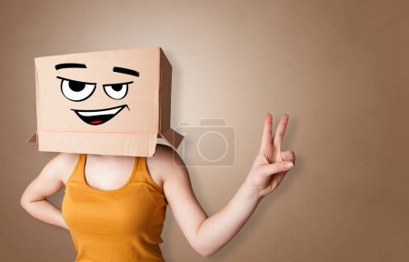 Young woman  with cardboard box on her head