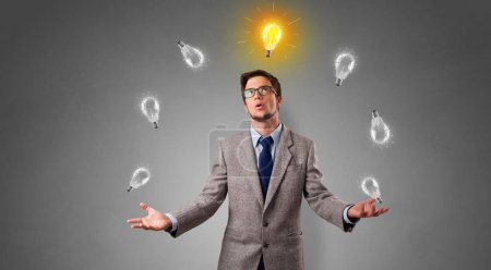 Photo for Young business person juggle with new idea concept - Royalty Free Image