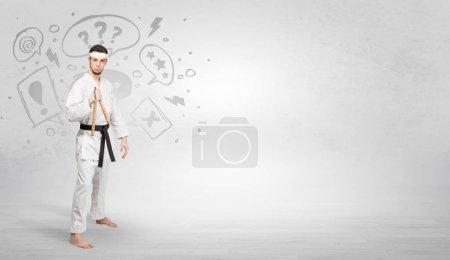 Photo pour Jeune entraîneur de kung-fu se battant avec le concept de symboles gribouillés - image libre de droit