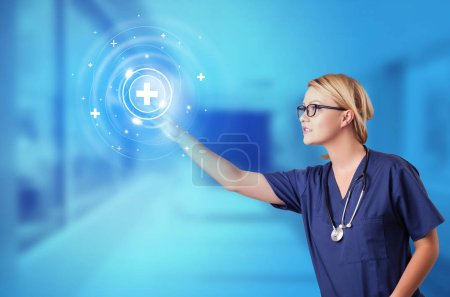 Photo for Doctor touching blue screen with call center concept - Royalty Free Image