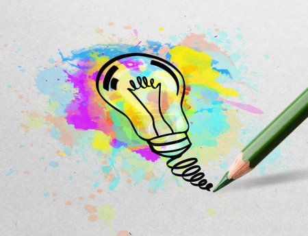 Photo for Drawing colorful bulb and multimedia symbols on white paper - Royalty Free Image