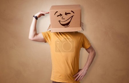 Photo for Young boy standing and gesturing with a cardboard box on his head - Royalty Free Image