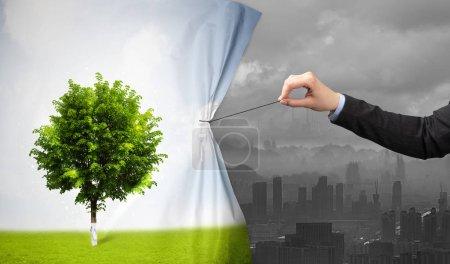 mano tirando de la naturaleza cityscape cortina a gris cityscape
