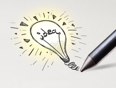 Photo for Pencil drawing new idea bulb on white paper - Royalty Free Image