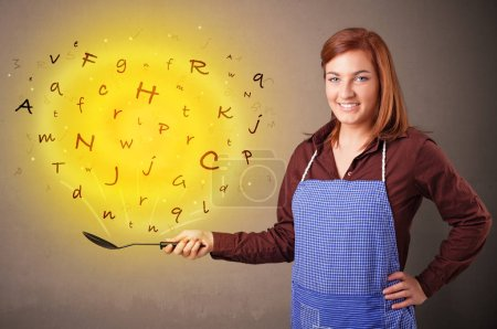 Photo for Young person cooking letters in wok - Royalty Free Image