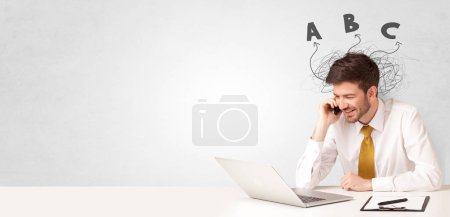 Photo for Handsome man teaching abc in classroom - Royalty Free Image