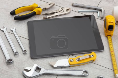 Household tools and tablet with empty screen