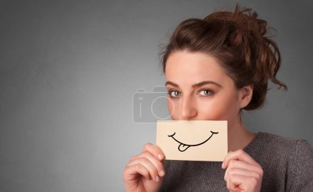 Photo for Person with smile card in front of his mouth - Royalty Free Image