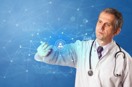 Photo for Doctor touching blue screen with virtual hospital concept - Royalty Free Image