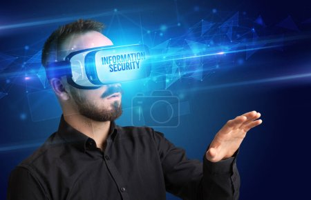 Photo for Businessman looking through Virtual Reality glasses with INFORMATION SECURITY inscription, cyber security concept - Royalty Free Image
