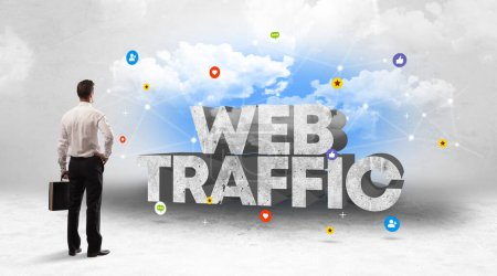 Photo for Young businessman standing in front of WEB TRAFFIC inscription, social media concept - Royalty Free Image