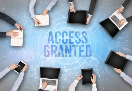 Photo for Group of people in front of a laptop with ACCESS GRANTED insciption, web security concept - Royalty Free Image