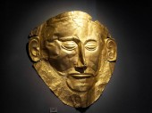 Athens - May 7, 2018: Famous golden Mask of Agamemnon which was discovered by archaeologist Heinrich Schliemann in 1876 in ancient Mycenae, Greece. Gold funeral mask close-up.