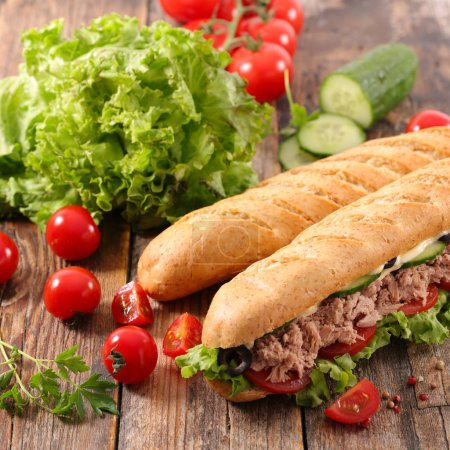 close-up photo of sandwich with tuna and salad