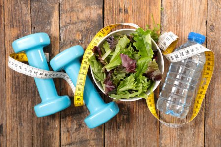 salad with water and dumbbell