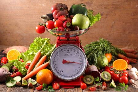 Photo for Balance with fruit and vegetables, diet food concept - Royalty Free Image