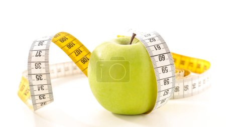 diet food concept with apple and measuring tape
