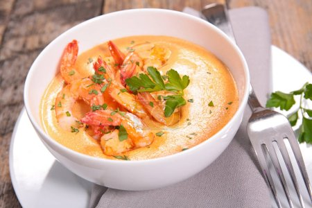 Spicy soup wiith shrimps and tomatoes with coconut milk