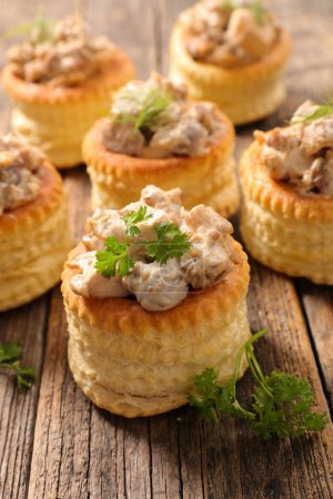 Photo for Vol au vent with cream and mushrooms on wooden surface - Royalty Free Image