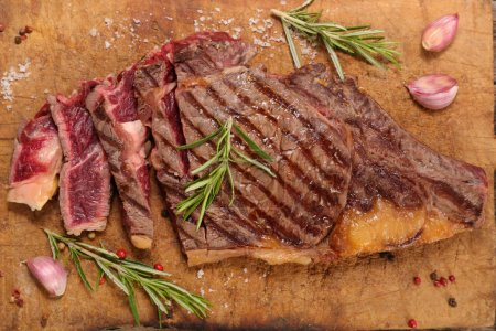 Photo for Grilled beef steak with rosemary herbs - Royalty Free Image