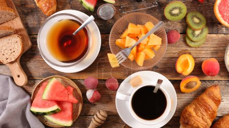 Photo for Breakfast table with tea, coffee, croissants and fruits, top view - Royalty Free Image