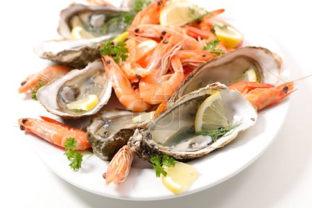 Photo for Food composition with shrimps and oysters on plate - Royalty Free Image